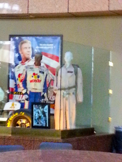 "because of the sunlight coming through the windows, I had to take this from a distance.  The costume on the right is Dan Akroyd's from ""Ghostbusters,"" and the one on the left is Will Ferrell's from ""Talladega Nights"""