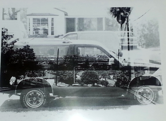 "as I mentioned above, my final project was ""super-imposition.""  For this print, I put together the negatives of my very first car, along with a negative of a shot looking down a hill.  Funny how easy it is to do now, using a computer..."