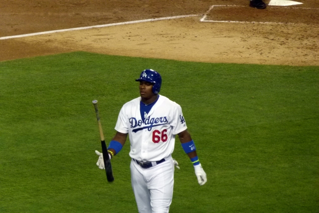 Yasiel Puig flipping his bat on the way back to the dugout after striking out.