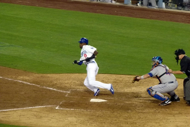 Dee Gordon heading to first after laying down a bunt.