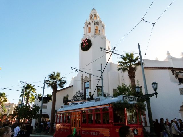 The Carthay Circle Restaurant with a Red Car Trolley in front.
